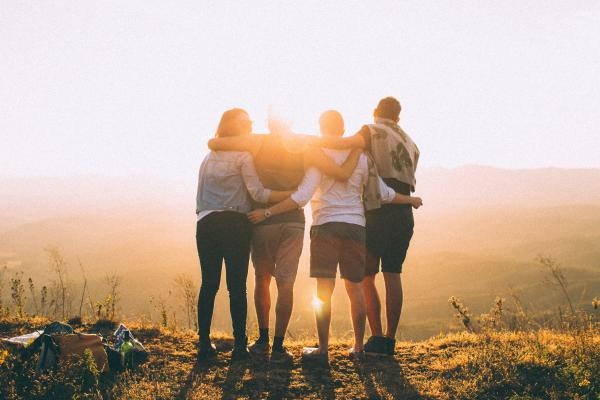 Canva Four Person Standing on Cliff in Front of Sun
